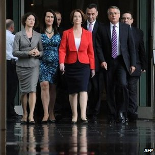 Julia Gillard (C) arrives with supporters for the caucus meeting in Canberra, 22 February 2012