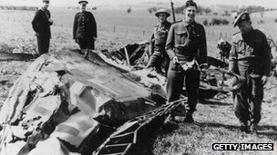 Soldiers looking at the wreck of Hess' plane