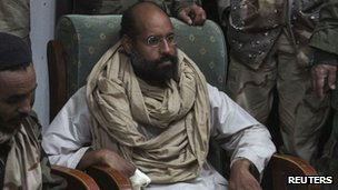Saif al-Islam Gaddafi is seen after his capture, in the custody of revolutionary fighters in Obari, Libya 19 November, 2011