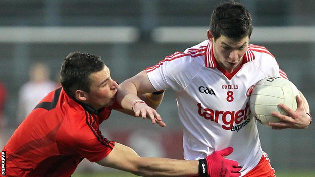 Down's David McKibben challenges Tyrone's Richard Donnelly at Casement Park