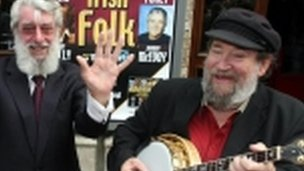 Barney McKenna, right, serenades fellow Dubliner Ronnie Drew, also deceased