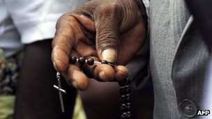 Angolan man with a crucifix during the Pope&#039;s visit to Luanda in 2009