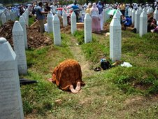 A Bosnian Muslim woman prays at a 2010 mass burial for victims of the 1995 Srebrenica massacre