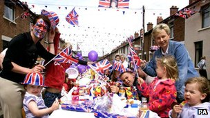 Locals celebrate Queen Elizabeth II's Golden Jubilee at a street party in south Belfast