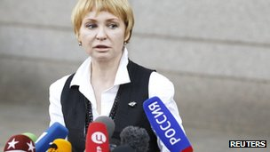 Viktor Bout's wife, Alla Bout, speakers to reporters outside the courtroom 5 April 2012
