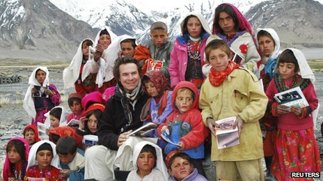 Greg Mortenson poses with children in Wakhan, north-eastern Afghanistan  11 March 2009
