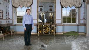 Man standing in 18th Century room ankle deep in water