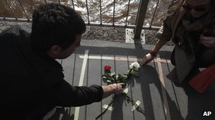Floral tributes are placed on a bridge in Sarajevo, 6 April 2012