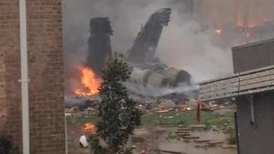 Debris from US Navy jet that crashed into an apartment building in Virginia Beach, Virginia 6 April 2012