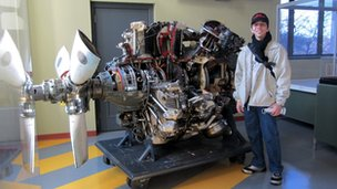 Man stands in front of engine