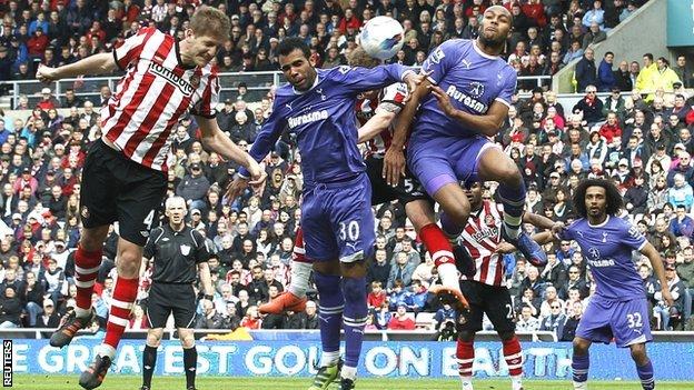 Sunderland's Michael Turner (left) heads on goal
