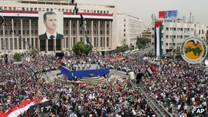  Assad supporters attend a rally in Damascus, 7 April