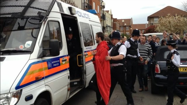 Man led into police van