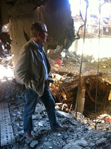Peter Taylor in the ruins of Musa Kusa's Tripoli HQ, which was bombed by Nato