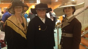 Three women dressed in vintage clothing