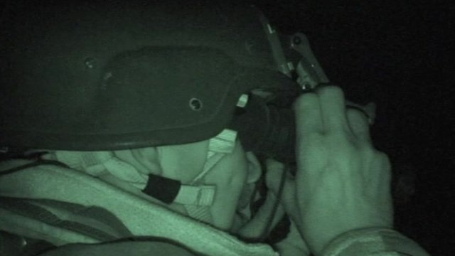 An officer carrying out a night raid