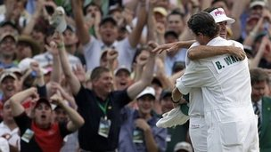 Bubba Watson celebrates winning the Masters with his caddie Ted Scott