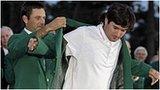Bubba Watson gets his Green Jacket from 2011 winner Charl Schwartzel