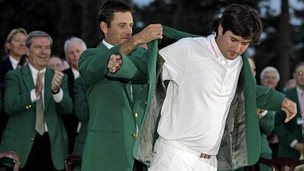Bubba Watson gets his Green Jacket from 2011 winner Charl Schwartzel