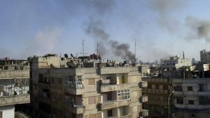 Smoke rises from the Al Qusoor district of Homs April 8, 2012