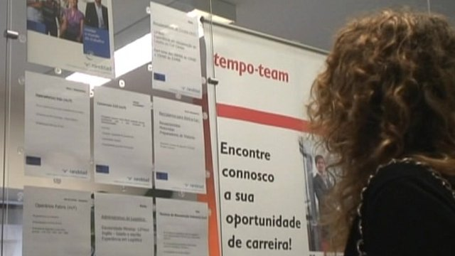 Woman looking at job adverts