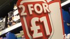 2 for £1 sale sign in supermarket