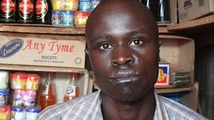 Geoffrey Obita, who was attacked by the LRA in 2003, in his shop outside Kitgum town in 2012