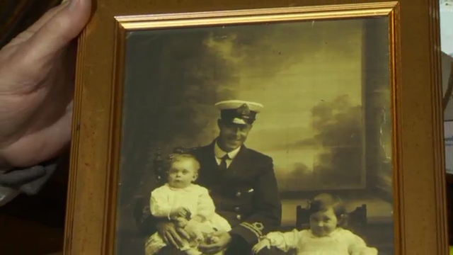 A photograph of Commander Harold Lowe with his grandchildren