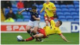 Cardiff winger Craig Conway is challenged by Watford's Jonathan Hogg