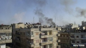Smoke rises from the al-Qusoor district of Homs 8 April, 2012.