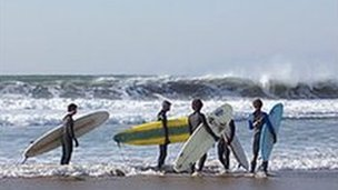 Surfers at Woolacombe Beach, Devon