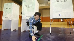 An election official does last-minute preparations before the parliamentary poll