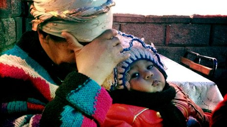 An Uzbek woman and child