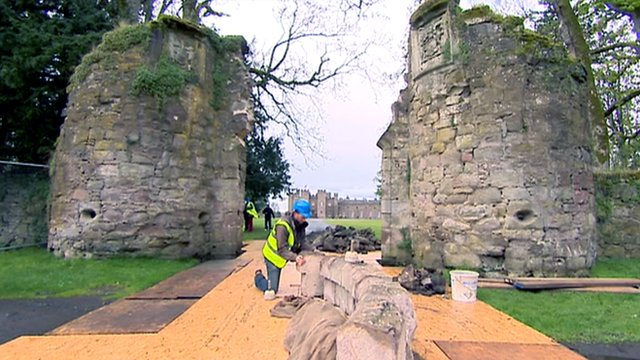 Stonemason working on a stone archway at Scone Palace