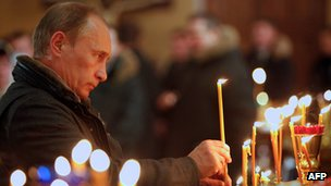 Vladimir Putin lighting candle in church, 7 Jan 11