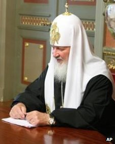Patriarch Kirill sits at table