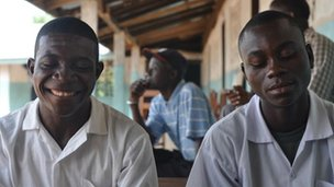 Two young men in school, Bong County, Liberia, 9 April 2012