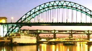 Tyne Bridge at night with Tuxedo Princess moored beneath, on a Royal Mail stamp