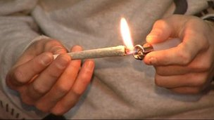 Man lights up joint