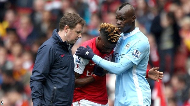 Alex Song and Mario Balotelli