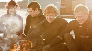 Rupert Grint (second right) in the TV advert for the Holidays at Home 
