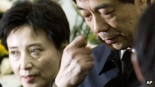 Chongqing Communist Party Secretary Bo Xilai, right, accompanied by his wife Gu Kailai
