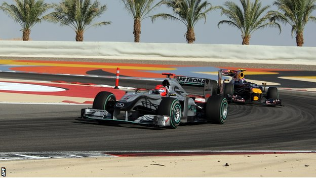 Michael Schumacher and Mark Webber at the 2010 Bahrain grand prix