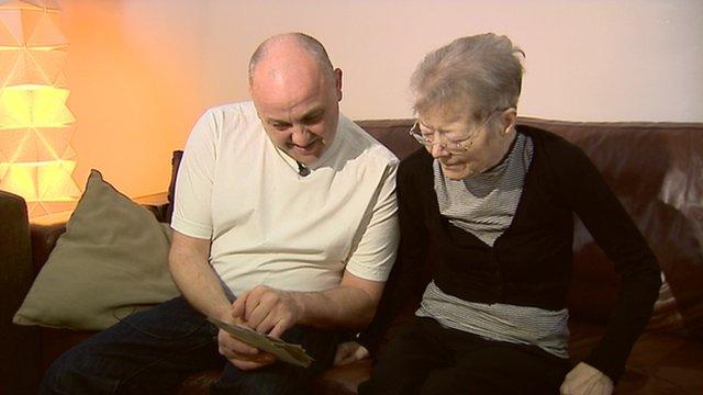 Man and woman look at photographs