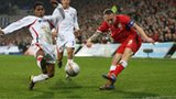 Craig Bellamy fires a shot against Costa Rica