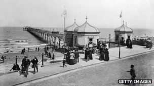 People walking along the promenade beside the pier at Redcar, Cleveland circa 1890. Photo: Hulton Archive/Getty Images