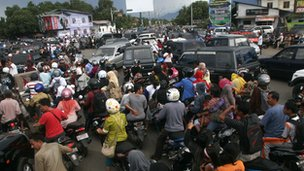Crowds of people try to make it to higher ground in Aceh, Sumatra, Indonesia.