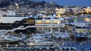 Luxury yachts are moored in the port of Cannes