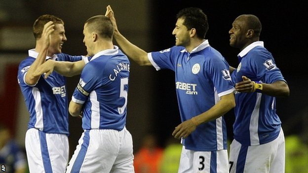 Wigan players celebrate their win over Manchester United