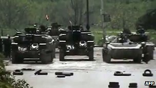 Still of Syrian tanks in Homs from activist video uploaded to YouTube 9 April